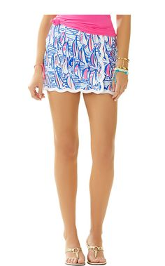 The Michelina Skort is a navy and white scalloped skort that we're loving. Wear this mini skort with a white tank and boat shoes for a nautical look/
