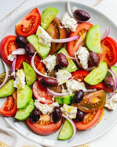 This authentic Greek salad is packed with fresh tomatoes, crisp cucumber, salty feta cheese, and briny olives: just like they make it in Greece! Greek Cucumber Sauce, Cucumber Tomato Salad, Avocado Salad Recipes, Best Salad Recipes, Watermelon Salad, Greek Salad, Caprese Salad, Healthy Recipes, Diet Recipes