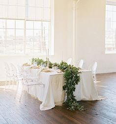 Beautiful greenery garland draped across a white-washed tablescape. Maybe that blue-ish table cloth with the greenery garland runner? Gardens Floral and Wedding Stylist Party Decoration, Reception Decorations, Table Decorations, Wedding Trends, Wedding Blog, Wedding Styles, Wedding Ideas, Wedding Planning, Low Centerpieces