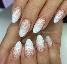 Glittery almond white acrylic nails
