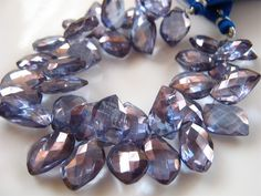SALE- 3 Inch 1/2 Strand of Pretty Blue Mystic Quartz Mango Faceted Briolettes semi precious gemstone beads 7mmx12mm -10mmx14mm by BohoBoutique on Etsy https://www.etsy.com/listing/220945172/sale-3-inch-12-strand-of-pretty-blue