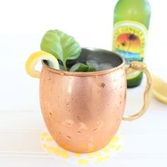 Peach Basil Moscow Mule | Ingredients: ¼ cup fresh basil, 1 large lemon (quartered), 8 oz peach vodka, 24 oz ginger beer.   Fill four glasses with ice. Preferably copper cups, but any cocktail glass will work!  Add 2 oz vodka and 6 oz ginger beer to each glass. Squeeze one quarter of a lemon into each glass, then add a couple pieces of fresh basil.  Stir.