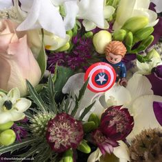 Close up detail of a Bridesmaid bouquet incorporating a Lego 'Captain America' character provided by the Bride & Groom. At a distance it's a beautiful bouquet. It's only up-close when you spot the character do you understand the wedding theme. The Wilde Bunch keeping theme's classy and subtle.
