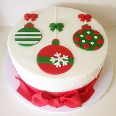 Classic Christmas ornaments top this chic Christmas Cake. The cake features quilted patterns on the side, and is tied with a big, red bow at the base. Christmas Cake Designs, Christmas Cake Decorations, Christmas Cupcakes, Christmas Sweets, Holiday Cakes, Christmas Cooking, Christmas Goodies, Xmas Cakes, Christmas Tree