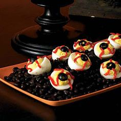 "Whip up a batch of creamy deviled eggs and then turn them into eerie-looking ""eyeballs"" with a few simple additions."