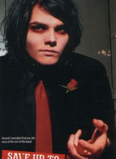 Gerard Way ~ My Chemical Romance. Gerard's invisible iPod was the envy of the rest of the band, lol.