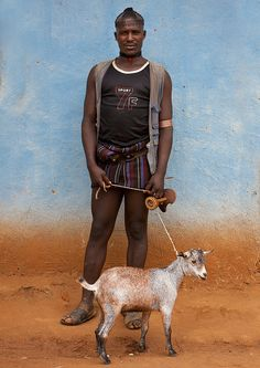 Tsemay man with his goat in market - Ethiopia by Eric Lafforgue, via Flickr