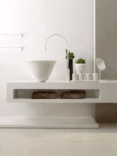 Goodly Bathroom Taps  24 Examples Interiordesignshome.com Minimal white tap and sink