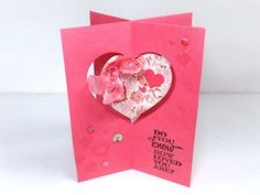 Splitcoaststampers - Four Way Card- by Dina Kowal...(just in time for Valentine's Day)...Create a standing dimensional card with a suspended ornament in the center.