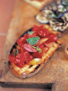 A bruschetta is a kind of open sandwich and it's probably where the idea for cheese on toast originally came from. It's normally made from a large loaf of sourdough natural yeast bread, which is a dark grey colour and has a higher water content than usual in the dough. It also has a thick crust and, because of this, moisture is retained in the bread, meaning it can be used up to a week after purchasing. Have a look round a farmers' market or in a good supermarket and you should be able to…