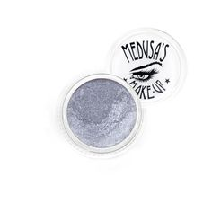 "Medusa's Makeup Eye Dust - Silverado. Shimmery pure silver. Vegan. Medium Intensity. Medusa's Make-Up Eye Dust is truly an amazing mineral eye shadow in the form of fine loose powder, think powdered sugar. This all natural mineral eye dust is by far the best in the industry. It glides on the skin like silk and wears well all day long. Each color carries it's own characteristics, some shimmer, sparkle, some have iridescence and many are highly pigmented. Apply ""Stick It"" to get a more..."