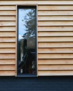 modern timber cladding and dark painted brick - love love love mix of dark painted brick with coordinating windows and cladding Wood Cladding Exterior, Larch Cladding, Wood Facade, House Cladding, Cladding Ideas, Exterior Signage, Exterior Stairs, Exterior House Colors, Exterior Paint