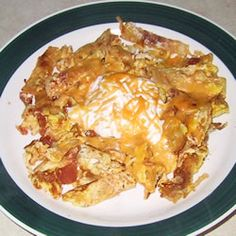 Mexican (breakfast dish) Chilaquiles I Love when My Elsa makes breakfast with her homemade Salsa and Chilaquiles with mashed homemade Beans with salt pork mmmmmm I am Hungre now...........