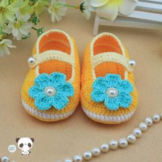 yellow Crochet Baby Booties  baby shoes  lovely girl booties, blue flowers newborn-12 months. $9.99, via Etsy.