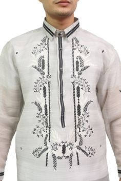 This Barong comes with contrasting colors to make you stand out in any occasion. Fabric: Jusi (Silk) with pina effect. Collar: Sports collar Design: Black and white U-embroidery. Special Feature: Piping on hard collar, placket, and cuffs. Beach Formal Attire, Formal Wedding Attire, Wedding Dresses, Wedding Guest Men, Barong Tagalog, Collar Designs, Wedding Costumes, Groom Attire, Chino Shorts