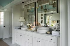 Four mercury glass pendants hang above the spacious double vanity.  #HGTVDreamHome