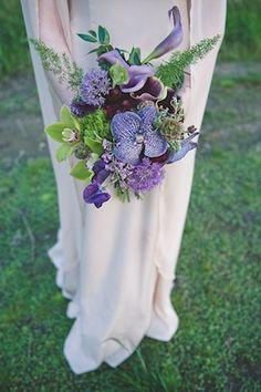 Purple orchid bridal bouquet | Bit of Ivory Photography & Palette of Petals | see more on: http://burnettsboards.com/2014/05/disneys-maleficent-inspired-wedding/ #orchid #bouquet