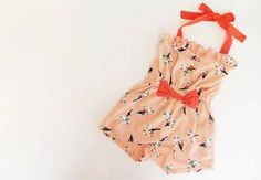 Adorable Orange retro stylish baby girl jumpsuit. The ideal outfit for your little princess to look so cute for springtime play. Decorative floral pattern with a beautiful ribbon around your baby's waistline.
