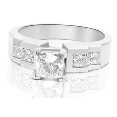 Present yourself with our luxuriant 14KT white gold diamonds engagement ring. Composed with 1.15CT princess cut breathtaking diamonds . This engagement ring features exquisite diamonds of H-I color and, SI3-I1 group clarity. Shine with elegance and simplicity with our 14KT white gold diamonds engagement ring.