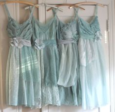 the style of bridesmaids dresses, each one is a different color w/ an ombre effect starting with blush to a more saturated rose