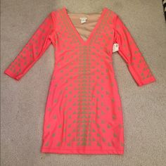 Brand New V Neck Dress Brand new with tags! Neve worn! Like a Salmon dress with Green Deco Pattern. Ellie's Couture Dresses