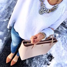 Casual fall/winter outfit. White sweater, denim jeans, and flats. Cute necklace and purse.