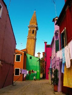 The island of Burano, in the Venetian lagoon, is known for its brightly painted houses and for traditional lacemaking. The Church of San Martino's campanile leans at the same five degrees as Pisa's tower.