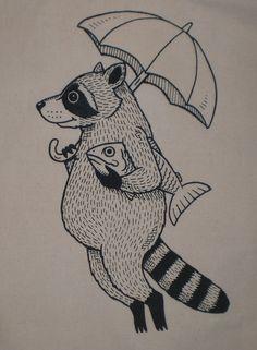 mapache con pez