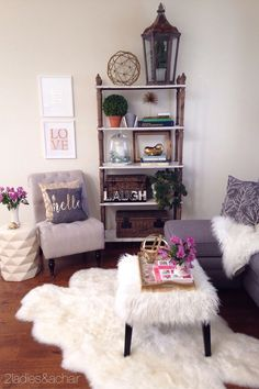 We added much needed warmth and color to this space. The beautiful gray  sofa and slipper chair are fabulous neutral furniture pieces we bought at  HomeGoods!
