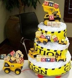 Boy diaper cake: Diaper Your Cake located in Jacksboro, TX was started in October 2010 after three of our friends were having baby showers, all within three weeks of each Diaper Cake Boy, Nappy Cakes, Diaper Cakes For Boys, Diaper Truck, Baby Shower Diapers, Baby Boy Shower, Diaper Shower, Bebe Shower, Baby Shower Crafts