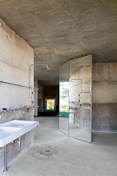all cement bathroom love the mirror wall