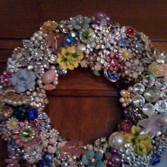 I made this out if old brooches which where my grandmother's, mother's, aunt's and mine (I also purchased some for fillers). I used a metal wreath and fastened the pins with flower wire and hot glue.