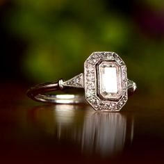 There is nothing like a unique morganite floral engagement ring to set her heart aflutter. Designed in striking detail, the ring features a twisted unique motif with a variety of side accent diamonds. A large 2 carat natural morganite sits atop in all Asscher Cut Diamond, Emerald Cut Diamonds, Halo Diamond, Diamond Cuts, Cushion Cut Diamonds, Halo Engagement, Vintage Engagement Rings, Unique Diamond Engagement Rings, Vintage Style Rings