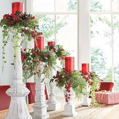 Bring festive charm and the beauty of nature to candles with our Set of Five Winter Berry Candle Rings. Instilled with designer flair, each features a    slightly different design and is crafted from a rich mix of lifelike greenery, ivy, red berries, and pinecones. Add them to your favorite candlestick set    to brighten up a table, mantel, or bookcase.            Set of five botanical candle rings in Christmas red and green                Five unique designs create a designer look      ...