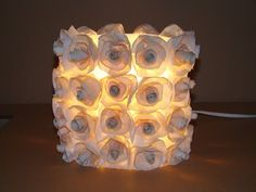 Believe it or not, this if a milk jug adorned with coffee filters turned lamp!  What a great idea from Make Handmade.