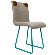 Furniture - Lola Turquoise Chair - Hutsly. Handcrafted in Poland, this chair doesn't look like any we've seen before! Featuring turquoise steel legs, grey upholstery and leather details, it would make the perfect desk chair. Or why not mix and match with other Lola chairs and dot them around the dining table?