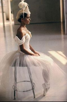 Feathers, white, posture, angles. Just dance.