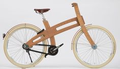 Dutch design Bough Bike. 28 inch or 26 inch frame, brown tires, additional front brake, and carrier.