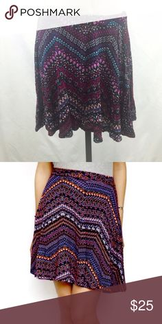 "Sololafe glory geometric mini skirt Patterned flowy skirt by SOLOLAFE. This is a brand new retail item, however the wholesaler did NOT send with hang tags. MADE IN USA!!! Mix of purple, red, white, black and blue. Very pretty & light! (Actual skirt is first photo and 2nd photo is wholesale model in different color scheme) 95% polyester 5% spandex - lots of stretch, measurements taken laying flat w/o stretching.  Small waist 21"" length 14"" Medium waist 25"" length 16"" Large waist 27.5"" length…"
