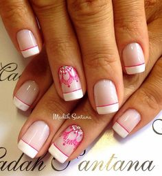 Pretty white and pink French tips. Add excitement to your white French tips while adding detailed lace designs in pink polish near the cuticles of your nails and adding silver beads on top for effect.