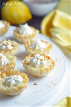 Small fillo (or phyllo) shells are filled with a lemon custard and topped with whipped cream and toasted coconut! @veryculinary