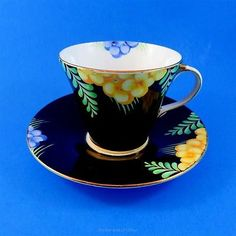 Art Deco Black with Yellow and Blue Flowers Aynsley Tea Cup and Saucer Set