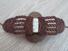 The bracelet is created with a 3D carved cow bone bead at the center of it and high quality waxed thread in earthy Brown color .The waxed thread is ideal for creating jewelry because it's waterproof and the jewelry maintain their original shape for years.  One of a kind creation, handmade by SelinofosArt. It's adjustable so it fits all sizes. Also it can be worn as an armlet. The Bone bead measures 2.6 cm , 1 inch.