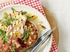 Grilled Chicken with Fresh Corn Cakes | Start with a package of cornbread mix and fresh corn kernels to make these homestyle corn cakes Top with grilled chicken, bacon and chopped arugula for a colorful one-dish dinner.