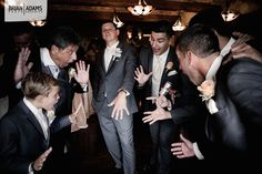 Groom Jacob with his groomsment and their reaction to his wedding ring at his wedding at Bella Collina in Montverde, Florida.  Wedding photo by Orlando Florida wedding photographer Brian Adams PhotoGraphics  www.brianadamsphoto.com