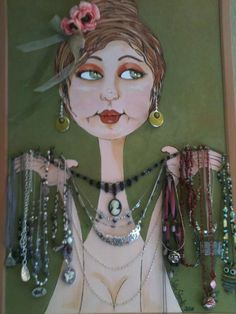 I painted this huge bulletin board and made it into a costume jewelry board.    I visit her daily :)