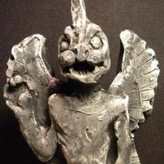 In Assyrian and Babylonian mythology, Pazuzu was the king of the demons of the wind, and son of the god Hanbi. He also represented the southwestern wind, the bearer of storms and drought.