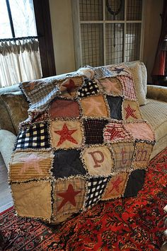 Flannel rag quilt with stars and initials of a boy I know...   (....cr....this quilt is wonderful for either girl or boy....just change a few of the colors but keep it rustic even for a girl....love it)