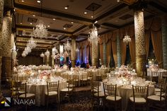 Gorgeous wedding reception photo in the Gold Coast room at the Chicago Drake Hotel - Luxury wedding - Gold colors with pink peonies, white roses, pink cherry blossoms, candles - Decor by Platinum Events -Picture by Chicago wedding photographer: Nakai Photography www.nakaiphotography.com