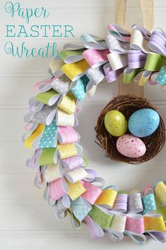Paper Wreath: Patterned paper, burlap ribbon, and plastic Easter eggs combine to form one colorfully creative wreath. Click through to discover more DIY ideas for easy Easter crafts. Diy Spring Wreath, Spring Crafts, Holiday Crafts, Wreath Crafts, Diy Wreath, Wreath Ideas, Couronne Diy, Diy Osterschmuck, Easy Diy